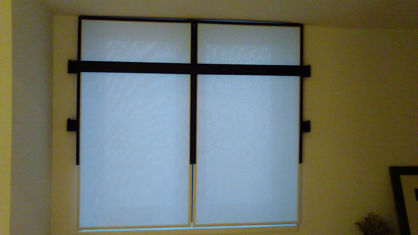 Custom window shade made with customer's own fabric and our custom fabricated black iron frames